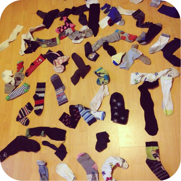 My dearest husband sorting out the year-old pile of odd socks that I've been collecting/hoarding.